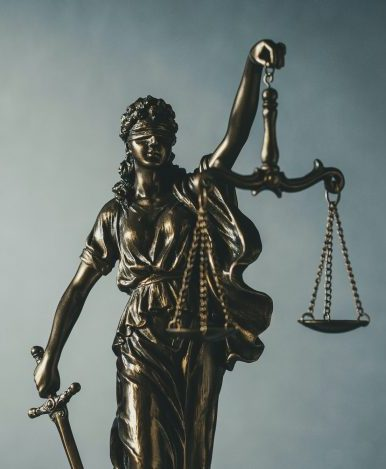 Brass statue of Justice holding scales and sword