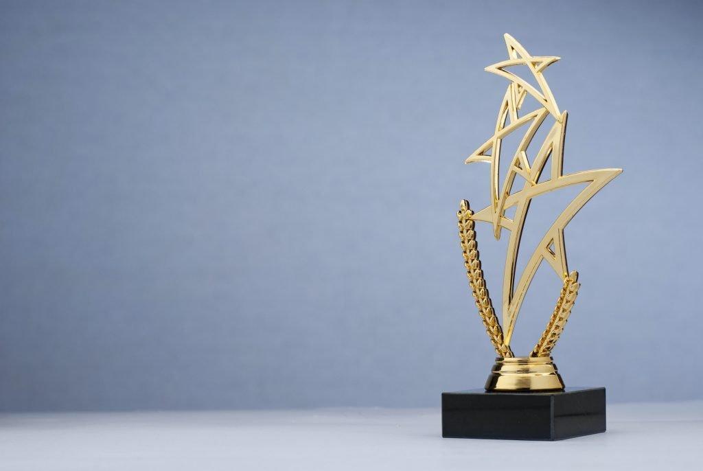 Golden triple star shaped trophy